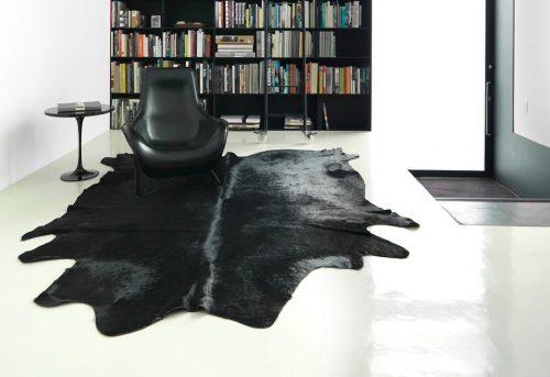 WILD cowhide black room scene